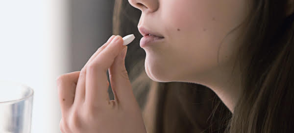 Image of women taking Enteris Biopharma oral drug delivery with fast rate of absorption.